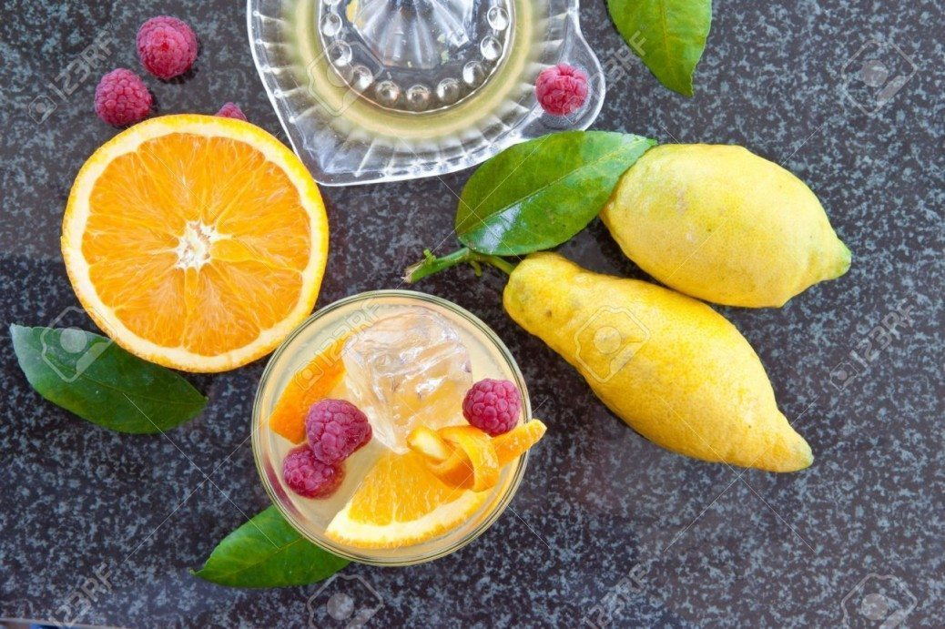 26912389-Fresh-homemade-lemonade-made-from-organic-oranges-lemons-and-raspberries-Stock-Photo
