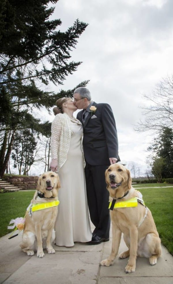 Undated handout photo issued by The Guide Dogs for the Blind Association (Guide Dogs) of guide dog owners Claire Johnson, 50 and Mark Gaffey, 51, who got married in Baralston, Stoke-on-Trent, after their dogs fell in love at training two years ago, their guide dogs, Venice (left) and Rodd, took the happy couple through the service and even acted as ring-bearers. PRESS ASSOCIATION Photo. Issue date: Sunday March 23, 2014. See PA story SOCIAL Dogs. Photo credit should read: The Guide Dogs for the Blind Association/PA Wire NOTE TO EDITORS: This handout photo may only be used in for editorial reporting purposes for the contemporaneous illustration of events, things or the people in the image or facts mentioned in the caption. Reuse of the picture may require further permission from the copyright holder.
