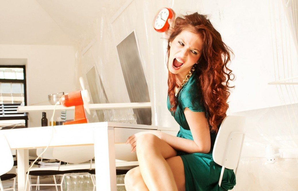 furious woman throw clock, sit in white modern room