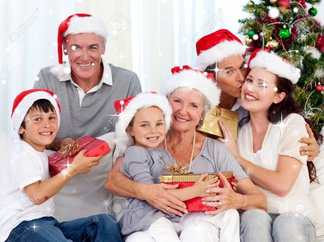 31861871-Smiling-family-at-Christmas-against-snow-falling-Stock-Photo