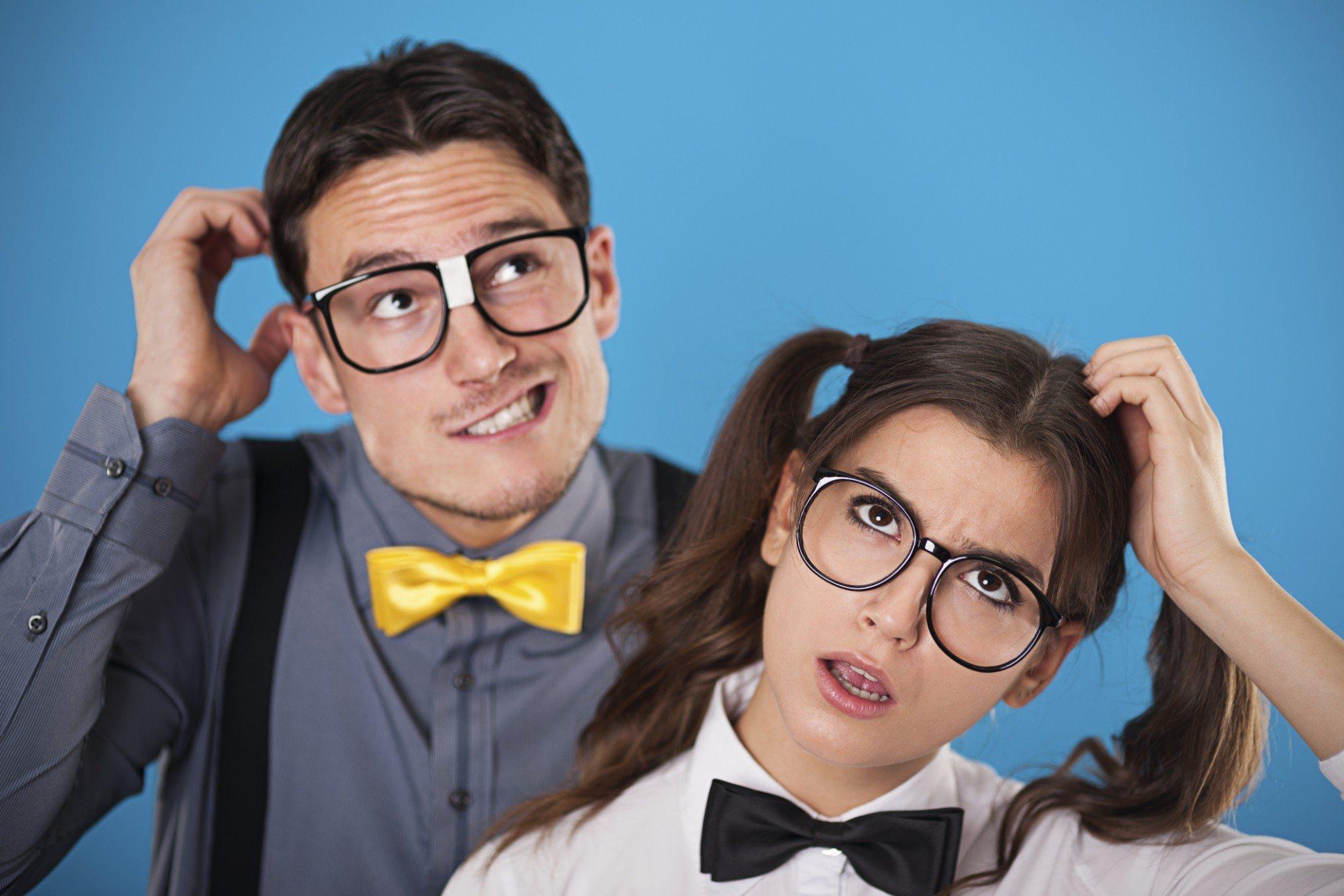 Portrait of wondering nerdy couple