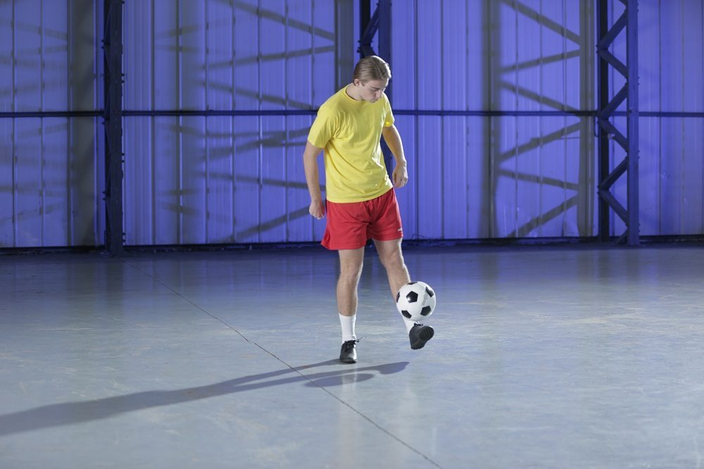 ESSEX, U.K. - Riley uses small, straight kicks to perform the keepy uppy. (Photo Credit: National Geographic Channels/Nick Marwick)