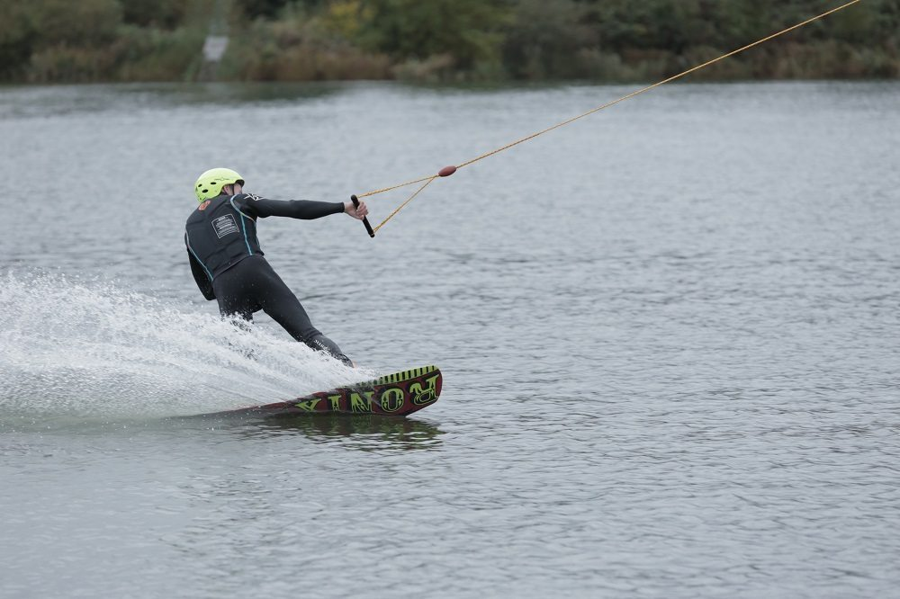 ESSEX, U.K. - Luke stays balanced by keeping the tip of the board above the surface of the water and leans back. Luke gains speed by moving from side to side on his board. (Photo Credit: National Geographic Channels/Nick Marwick)