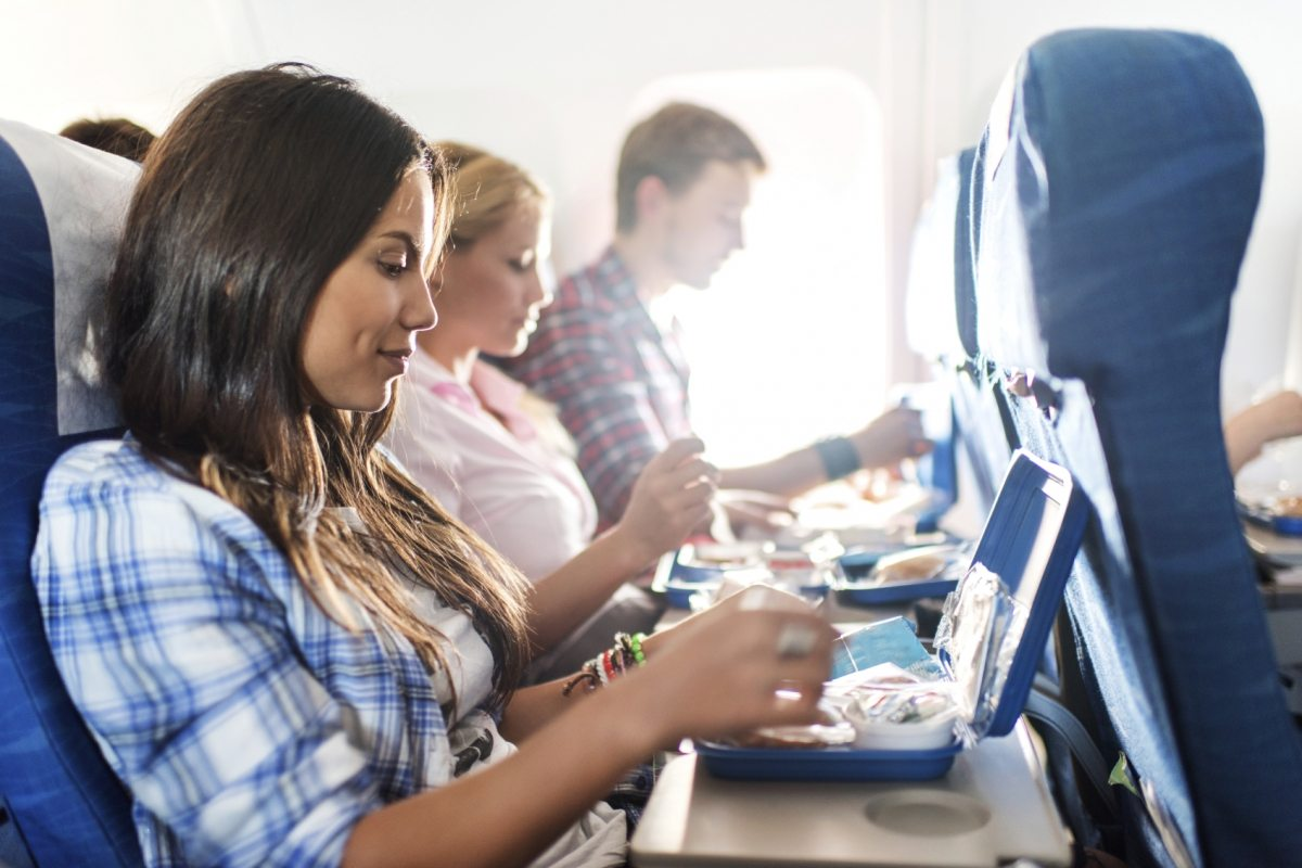 Eating-on-a-plane-1200x800